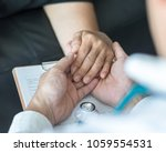 geriatric doctor consulting and ...   Shutterstock . vector #1059554531