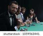handsome man playing in casino | Shutterstock . vector #1059563441