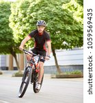 sporty man cyclist in cycling... | Shutterstock . vector #1059569435