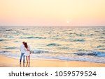 honey moon on the sea shore.... | Shutterstock . vector #1059579524