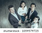 four smiling middle aged...   Shutterstock . vector #1059579725
