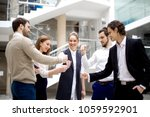 happy business team playing... | Shutterstock . vector #1059592901