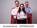 smiling super businesspeople in ... | Shutterstock . vector #1059601634