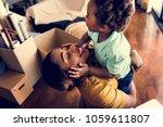 happy african descent family | Shutterstock . vector #1059611807