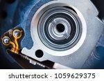 Small photo of closeup inside the hard drive, read write head actuator axis