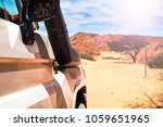 tourist white suv moves to meet ... | Shutterstock . vector #1059651965