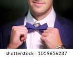 man's hands touches bow tie on... | Shutterstock . vector #1059656237