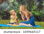 mom and son had a picnic in the ... | Shutterstock . vector #1059665117