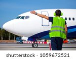 ground crew in the signal vest. ... | Shutterstock . vector #1059672521