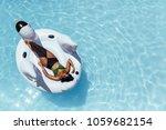 overhead view of woman in... | Shutterstock . vector #1059682154