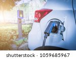 charging an electric car battery | Shutterstock . vector #1059685967