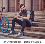 a handsome hipster traveler... | Shutterstock . vector #1059691091