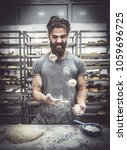 Small photo of Man juggle with dough for preparing donuts,selective focus