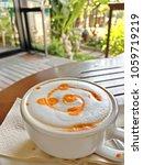 latte art of hot milk tea in...   Shutterstock . vector #1059719219