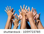 many hands raised up against... | Shutterstock . vector #1059723785