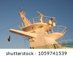 Small photo of Livorno, Italy - September 2011: The masthead of a modern cruise ship showing the radar and communications installations