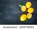 fresh lemons on dark stone... | Shutterstock . vector #1059748901