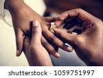 giving of wedding ring | Shutterstock . vector #1059751997