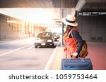 tourist is waiting a taxi in... | Shutterstock . vector #1059753464