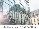 old house reflection in modern... | Shutterstock . vector #1059760055