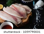 fresh fish fillet with... | Shutterstock . vector #1059790031