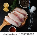 fresh fish fillet with... | Shutterstock . vector #1059790037