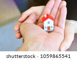 young family and buying a house ... | Shutterstock . vector #1059865541