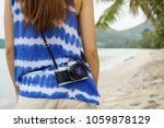 young woman with camera... | Shutterstock . vector #1059878129