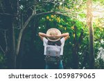 woman in the forest.enjoying... | Shutterstock . vector #1059879065