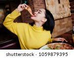 funny brunette girl in yellow... | Shutterstock . vector #1059879395