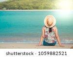 woman sitting on the beach   ... | Shutterstock . vector #1059882521