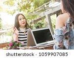 two teenage women meet in... | Shutterstock . vector #1059907085