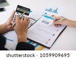 asian business adviser meeting... | Shutterstock . vector #1059909695