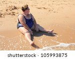 Overweight Woman Sitting On...