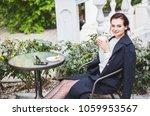beautiful woman drinking coffee ... | Shutterstock . vector #1059953567