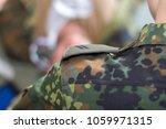 a shoulder strap on a german... | Shutterstock . vector #1059971315