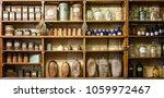 bottles on the shelf in old... | Shutterstock . vector #1059972467