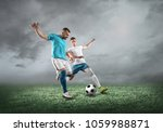 soccer players on a football... | Shutterstock . vector #1059988871