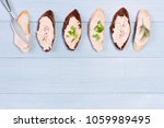 background with salmon pate on... | Shutterstock . vector #1059989495