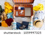 woman sit on bed with suitcase... | Shutterstock . vector #1059997325