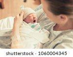 cute sleepy baby. mother... | Shutterstock . vector #1060004345
