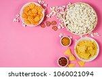 fresh popcorn  snacks and chips ... | Shutterstock . vector #1060021094