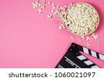 fresh popcorn and movie clip... | Shutterstock . vector #1060021097