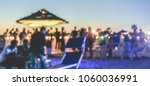 blurred people having sunset... | Shutterstock . vector #1060036991