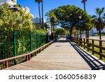 Small photo of Promenade. Promenade of Puerto Banus, Marbella, Malaga, Costa del Sol, Spain