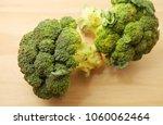 raw broccoli over wooden... | Shutterstock . vector #1060062464