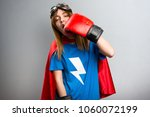 superhero girl with boxing... | Shutterstock . vector #1060072199