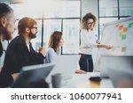 young coworkers working... | Shutterstock . vector #1060077941