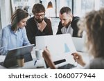 brainstorming process at office.... | Shutterstock . vector #1060077944