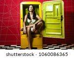 beautiful girl sitting in open... | Shutterstock . vector #1060086365